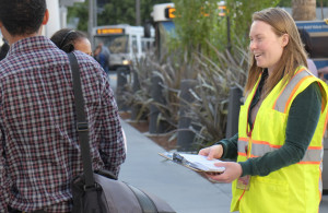 An SFMTA volunteer polling pedestrians. Links to Evaluating & Monitoring Our Progress page.