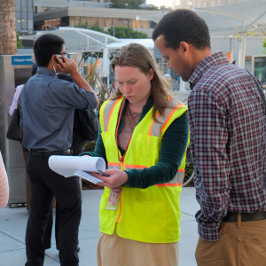 SFMTA volunteer polling a pedestrian. Links to Evaluating & Monitoring Our Progress page.