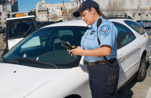 Trafficer Officer issuing a parking ticket.