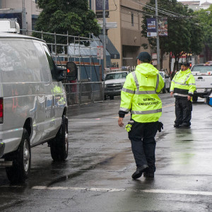 Traffic Officer directing vehicles. Links to Enforcing Traffic Laws page.